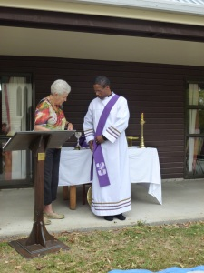 Patricia Gardner presents Rev. Llewellyn with his new purple stole to mark the start of Lent